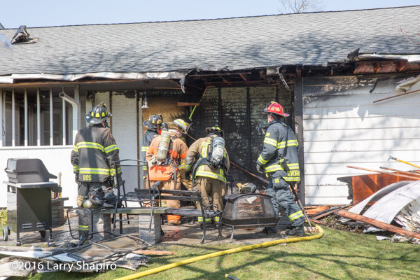 firefighters overhaul fire scene
