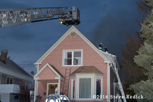 tower ladder at house fire