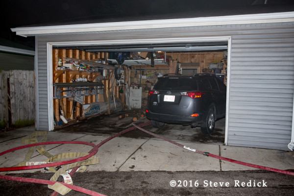 hose lines deployed through alley garage