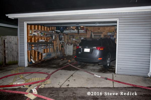 hose lines deployed through alley garage