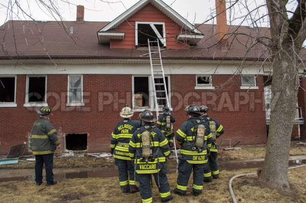 firefighters outside of house fire