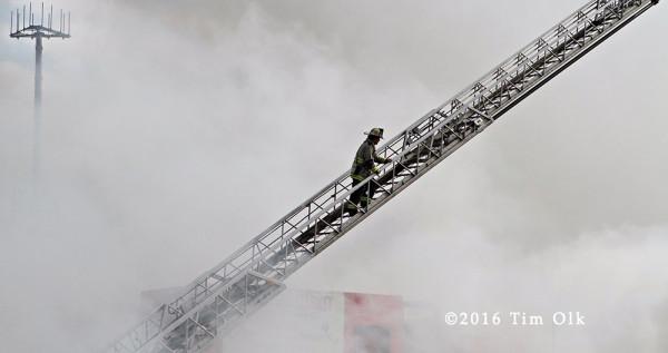 fireman climbing aerial at fire