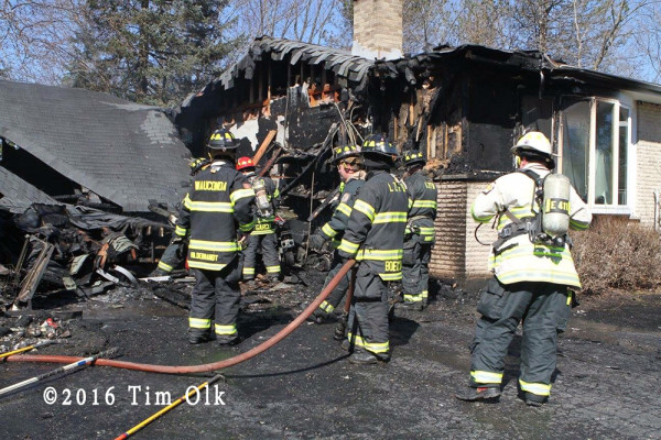 firefighters overhaul after garage fire