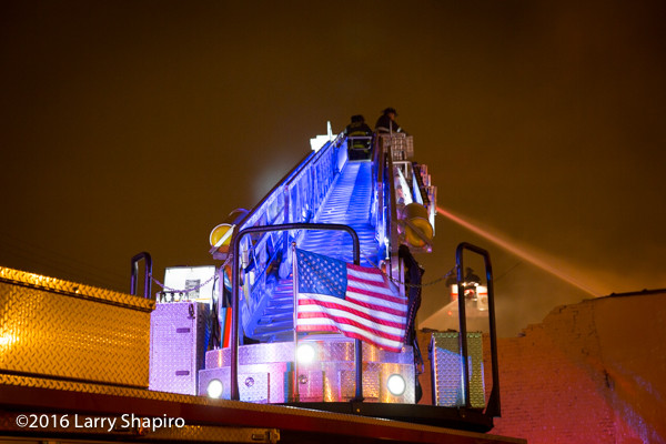 American flag on E-ONE fire truck at night
