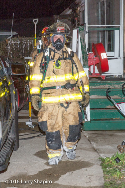 firefighter after battling a fire at night