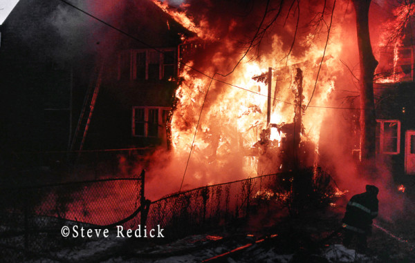 heavy flames at night fire scene