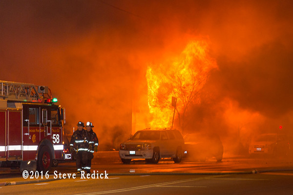 heavy flames from building fire at night