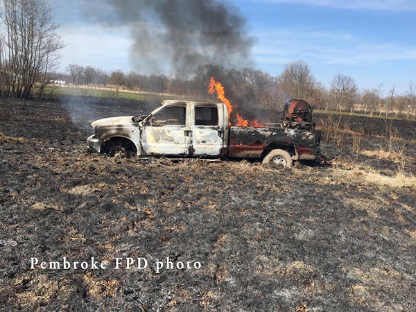grass fire burns fire truck