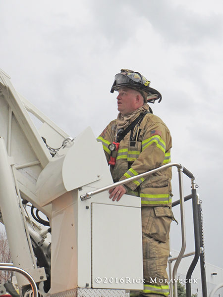 firefighter operating ladder truck