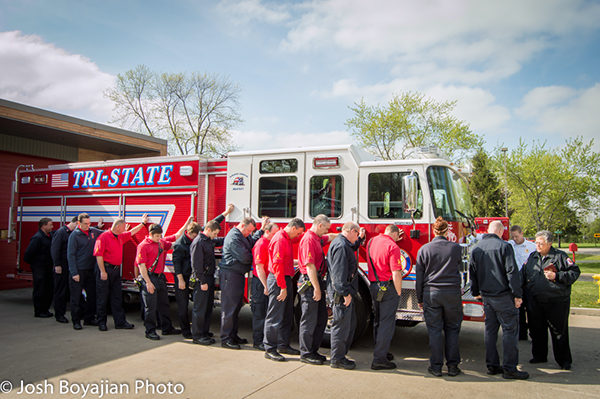 firefighters receive blessing with new fire engine