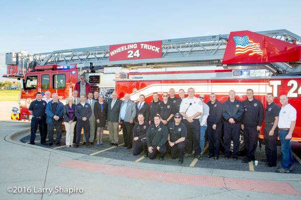 village trustees and firefighters with new Wheeling fire truck
