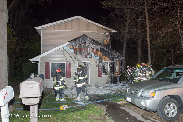 house fire aftermath with overhaul