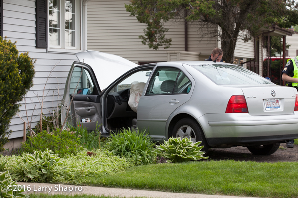car against house with air bag deployed