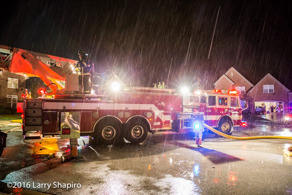 Wauconda fire truck at fire scene during rain storm