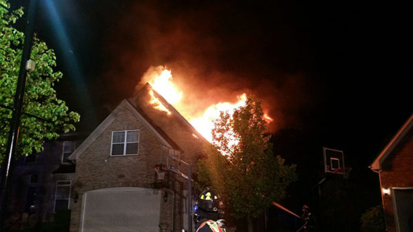 flames through roof of house