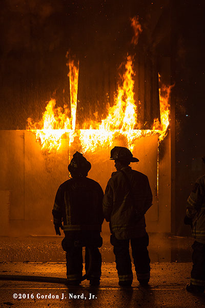 fire chiefs silhouetted by fire