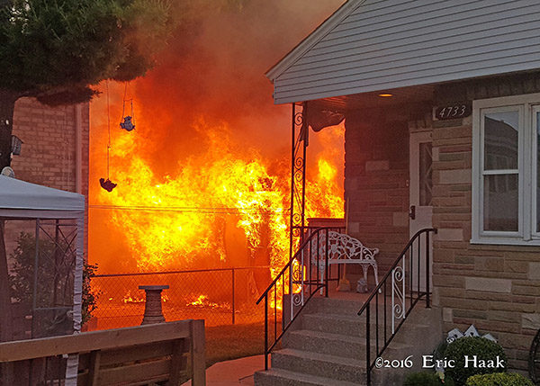 alley garage engulfed in flames