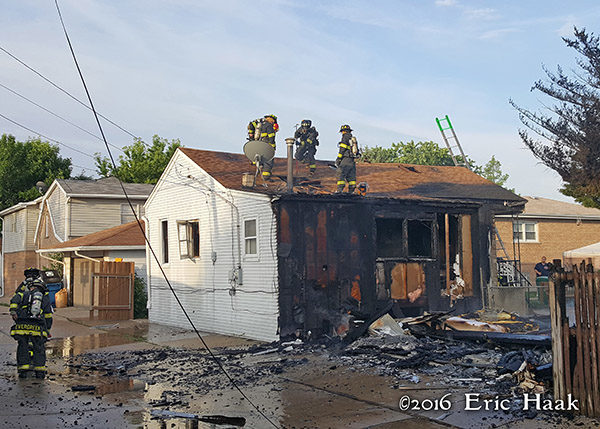 aftermath of alley garage destroyed by fire