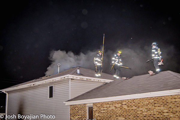 heavy smoke from small house on fire at night