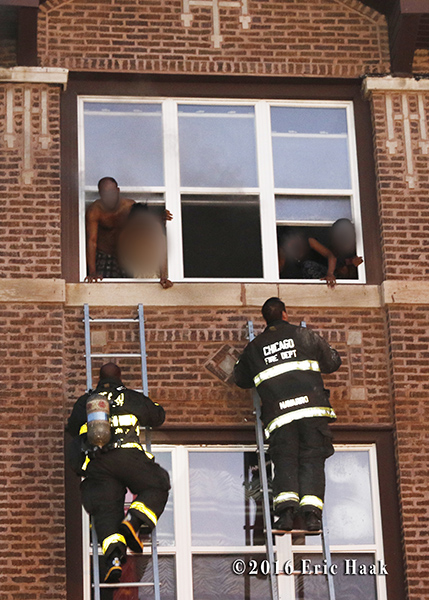 Chicago firefighters rescue victims with ladders