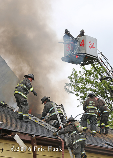 firefighters vent roof during house fire