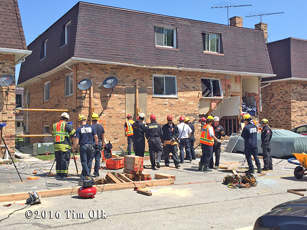 fire department technical rescue crews at a building collapse