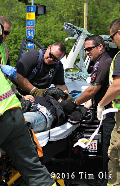 firefighters remove crash victim on backboard
