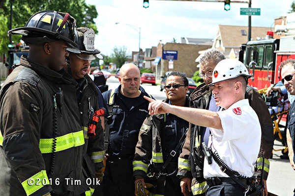 fire chief directs firefighters