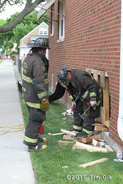 firefighters shore up damaged building
