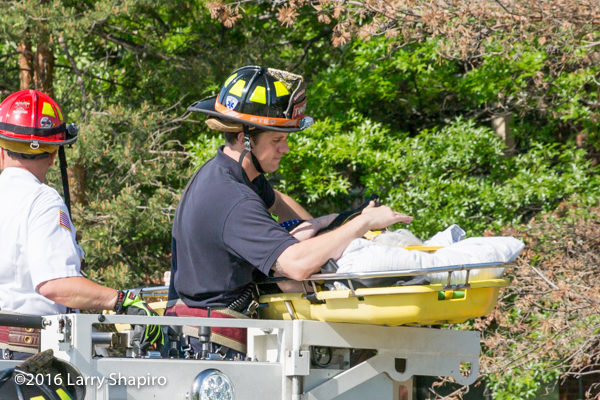 firefighter paramedic shows compassion to elderly patient