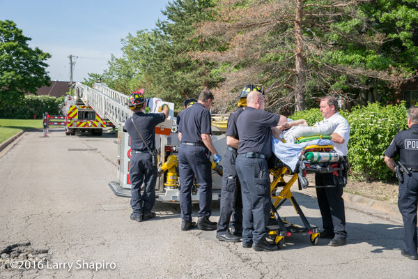 firefighters load patient on stretcher