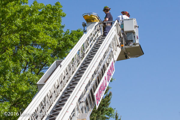 tower ladder with stokes basket removes patient