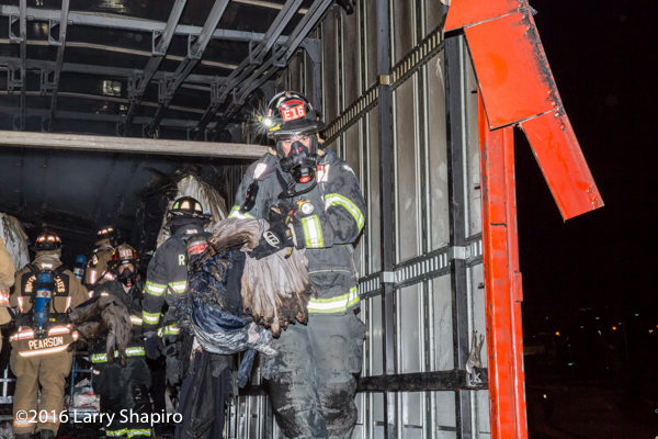 fireman empties truck contents after fire