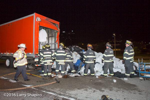firemen empty truck contents after fire