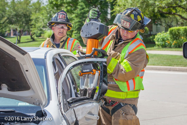 firefighter with Holmatro rescue tool