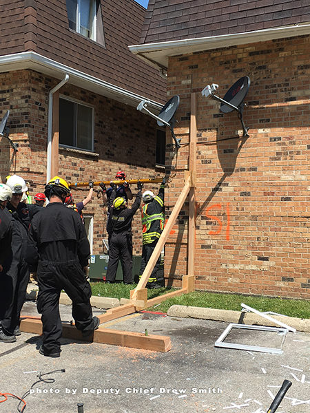 technical rescue team shores damaged building
