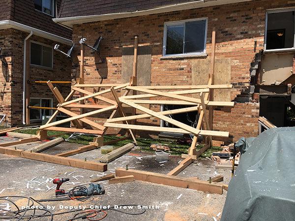 technical rescue team shores damaged building