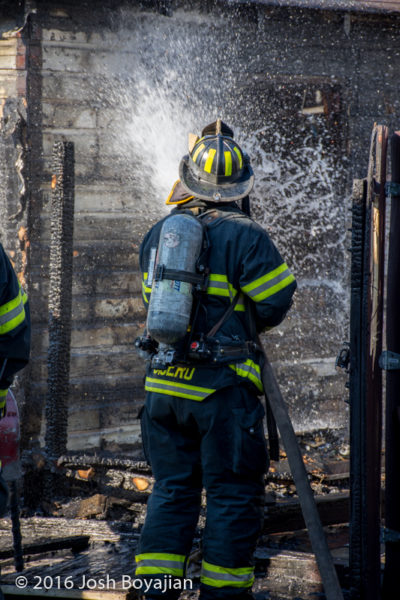 firefighter washes down after garage fire