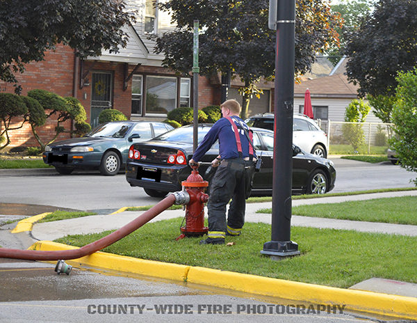 firefighter closing a hydrant
