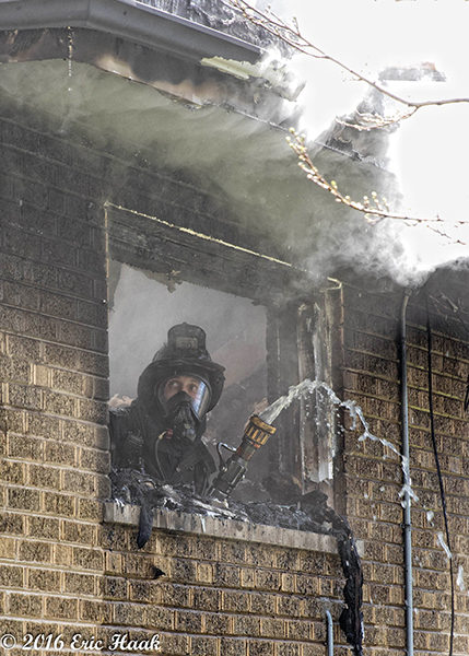 Chicago firefighter overhauls after house fire