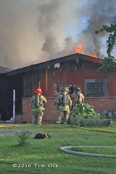 flames through roof during house fire