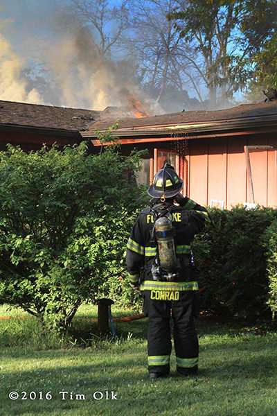 firefighter outside house fire