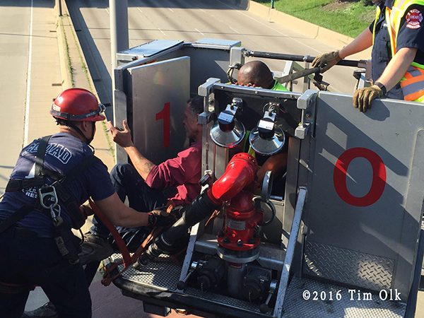 Chicago firefighters save a man threatening to jump onto the highway