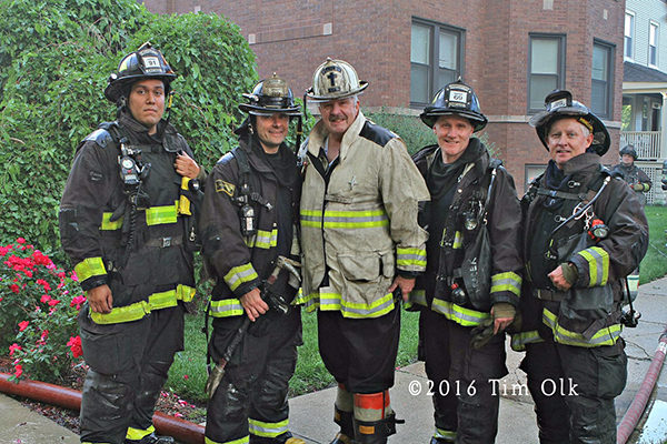 Chicago firefighters and chaplain after a fire