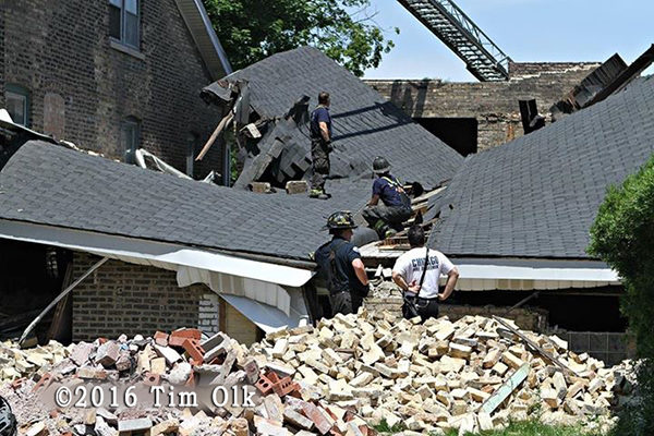 firemen work at building collapse