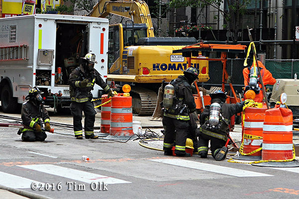 firefighters work at gas main break in Chicago Loop