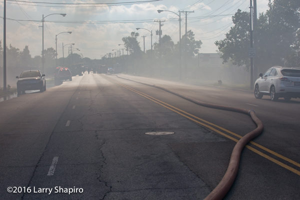 large diameter hose in street at fire scene