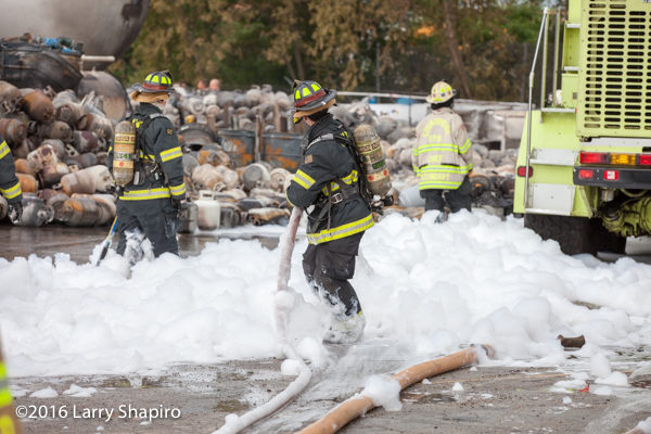 firefighters in foam after fire