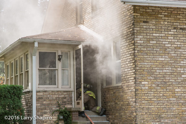 firefighter crawls into house on fire with smoke