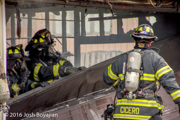 firefighters overhaul after garage fire